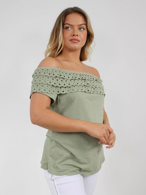 side shot of the Cilento Women Off The Shoulder Top in the Green featuring Broderie Anglaise frilled detailing and off the shoulder design