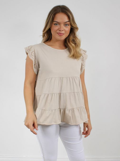 Front shot of the Cilento Women Ruffle Detail Top in the beige featuring cap sleeves with Broderie Anglaise detailing, rounded neckline and ruffle detailing to the bottom of the top