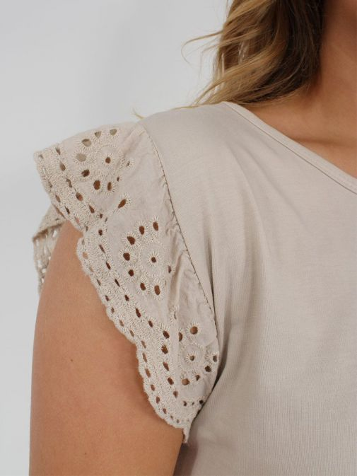 closeup shot of the Cilento Women Ruffle Detail Top in the beige featuring cap sleeves with Broderie Anglaise detailing, rounded neckline