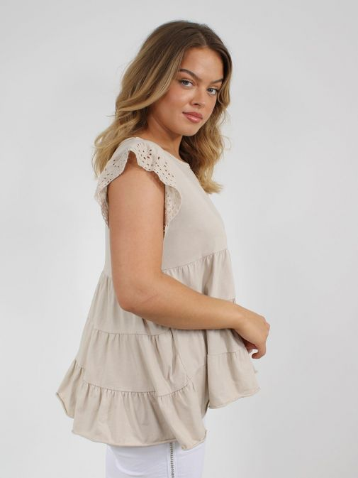 side shot of the Cilento Women Ruffle Detail Top in the beige featuring cap sleeves with Broderie Anglaise detailing, rounded neckline and ruffle detailing to the bottom of the top
