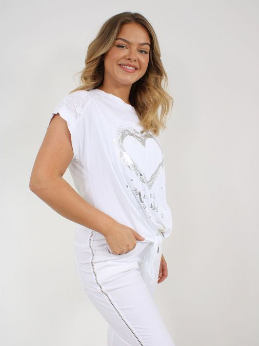 Side shot of the Cilento Women Silver Heart Detail Top in the White featuring heart detail, short sleeves, rounded neckline