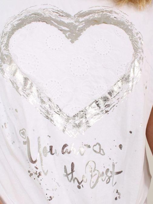 closeup shot of the Cilento Women Silver Heart Detail Top in the White featuring heart detail