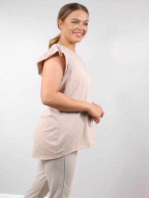 Side shot of Model wearing Cilento Woman Frill Sleeve Tee in Beige