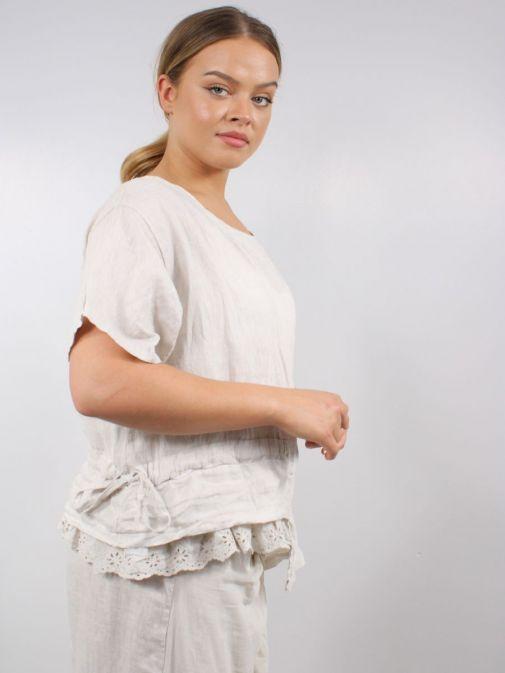 Side shot of model wearing Cilento Woman Linen Top in Beige