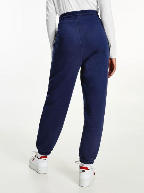 Back image of model wearing Tommy Jeans Badge Relaxed Joggers in Navy