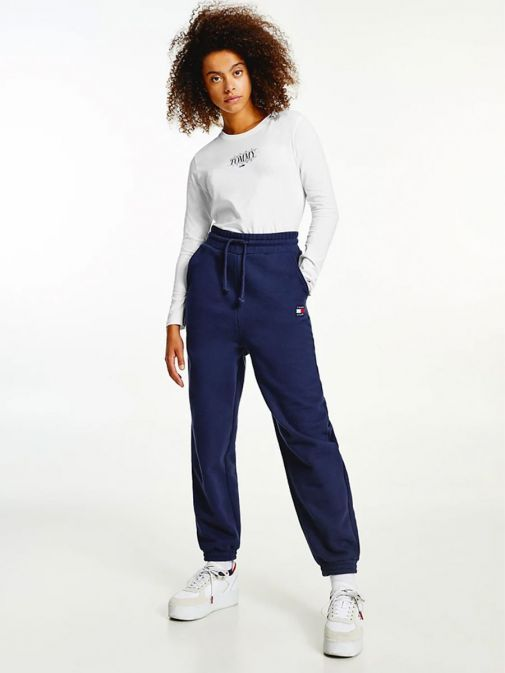 Full-length shot of model wearing Tommy Jeans Badge Relaxed Joggers in Navy