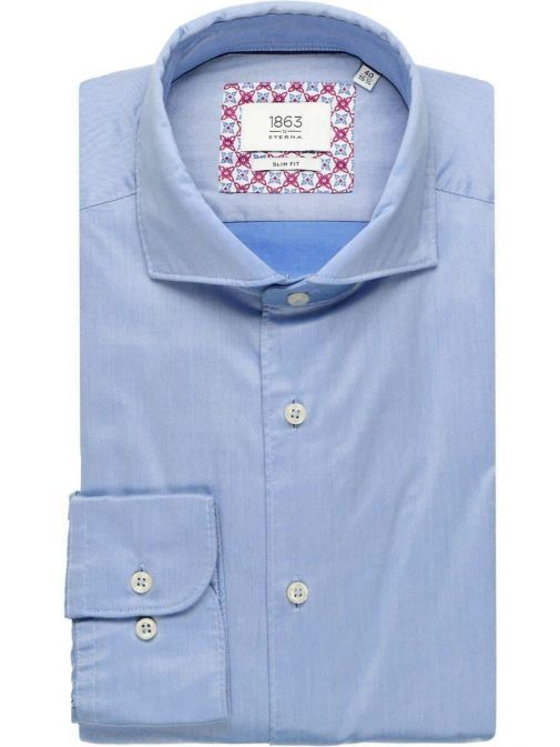 Front shot of the Eterna 1863 Slim Fit Shirt in the bright Blue colour featuring  hard collar, button fastening and long sleeves