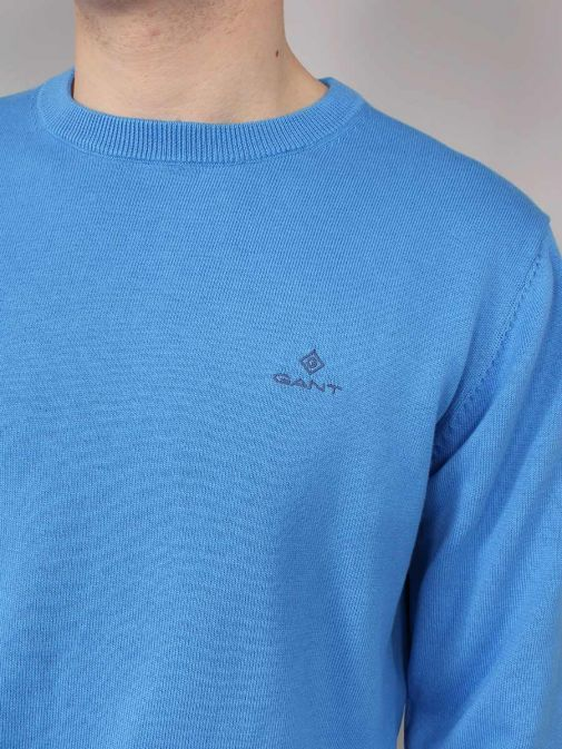 Closeup of the Gant Classic Cotton Crew Neck Sweater in the Blue Colour featuring long sleeves, rounded neckline and Gant Logo