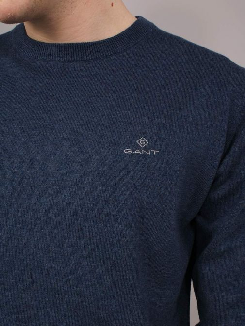 closeup of the Gant Classic Cotton Crew Neck Sweater in the Navy colour featuring long sleeves, Gant logo and rounded neckline