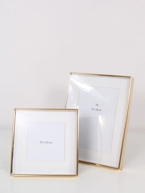 Image of Gold Recessed Photo Frame size 7x9 inches, pictured with a smaller frame from same range