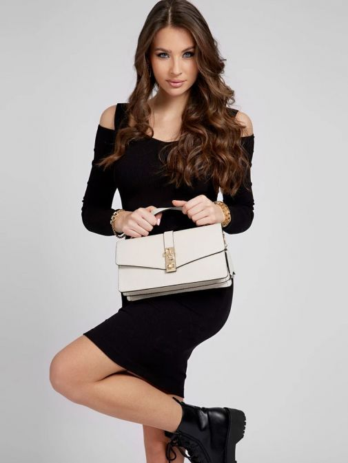 model shot of the Guess Albury Handbag Charm in the Beige featuring a small handle, long strap, guess the logo