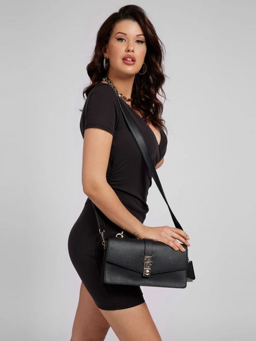 Model with Guess Albury Handbag with Charm in Black hanging off shoulder