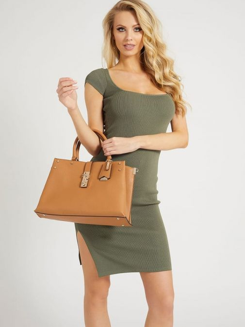 Image of model holding Guess Albury Maxi Handbag with Charm in Caramel