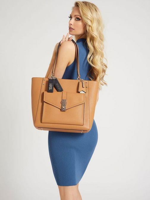 Model wearing Guess Albury Shopper with Charm in Caramel