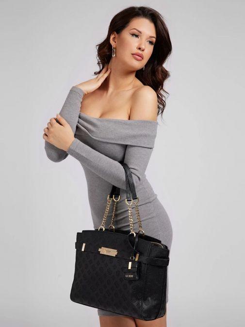 Model wearing Guess Bea embossed Logo Shopper in Black