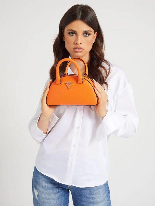 Model holding Guess Cordelia Saffiano Mini Handbag in Orange