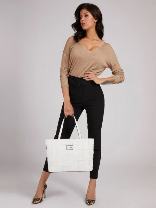 Model holding Guess Liberty City Braided Shopper in White