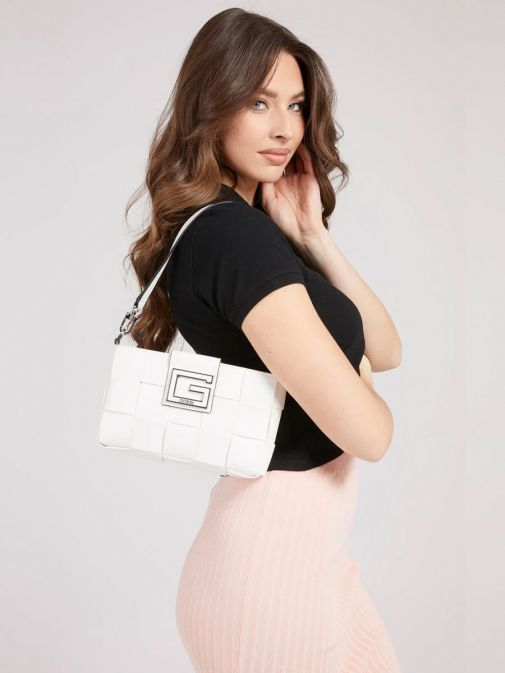 Model with Guess Liberty City Braided Shoulder Bag in White on her shoulder
