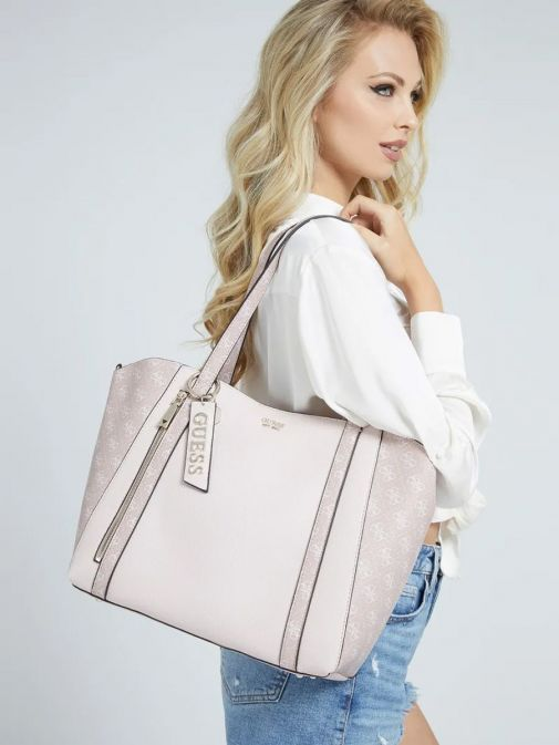 Model with Guess Naya Shopper Logo Pochette in Pink Multi on her shoulder
