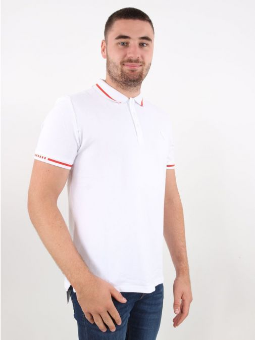 Model wearing Guess Slim Fit Polo in White