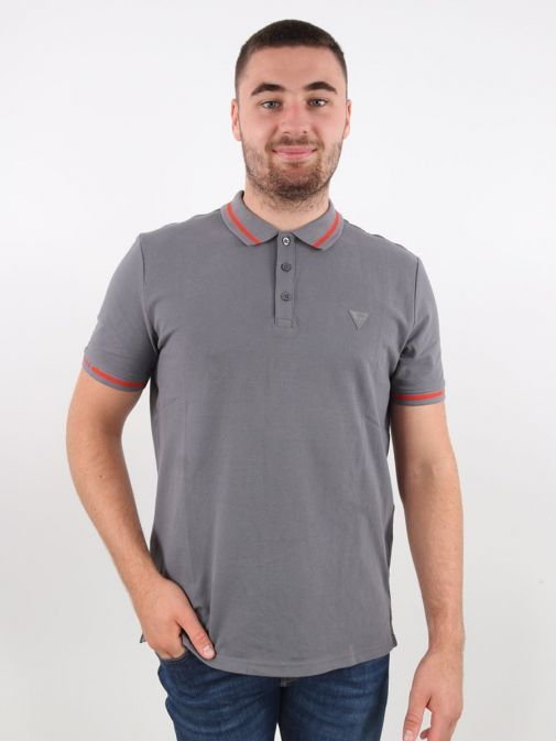 Alternative of model wearing Guess Slim Fit Polo in Grey
