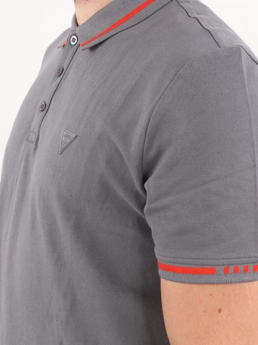 Close up of model wearing Guess Slim Fit Polo in Grey