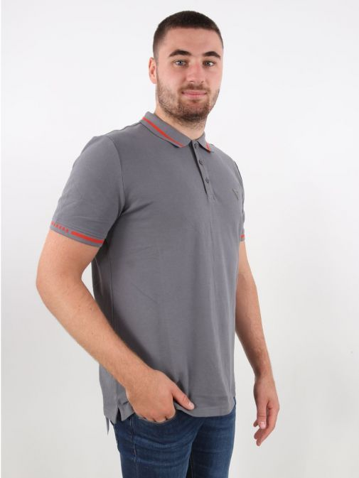 Model wearing Guess Slim Fit Polo in Grey