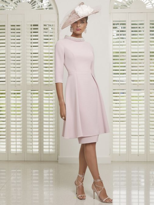 Model wearing Invitations by Veni for Ronald Joyce Pearl Neckline Dress in Blush, Style 991502C