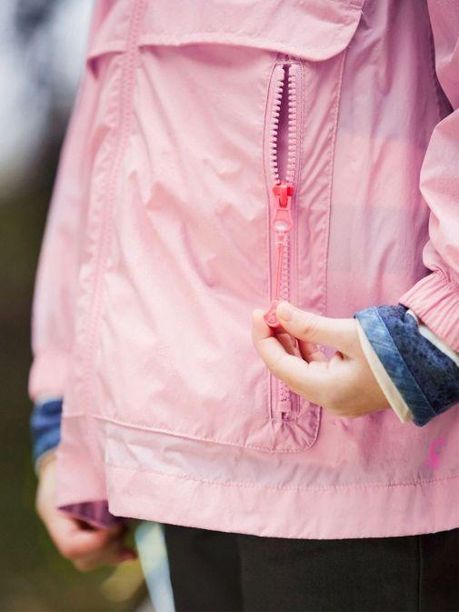 Close up of model wearing Joules Roseberry Waterproof Swing Rainmac in Pink