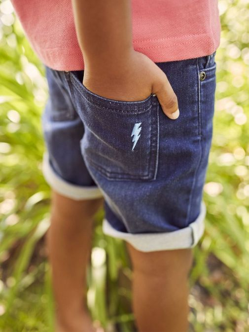 Model wearing Joules Brandon Jersey Denim Shorts in Dark Wash for boys