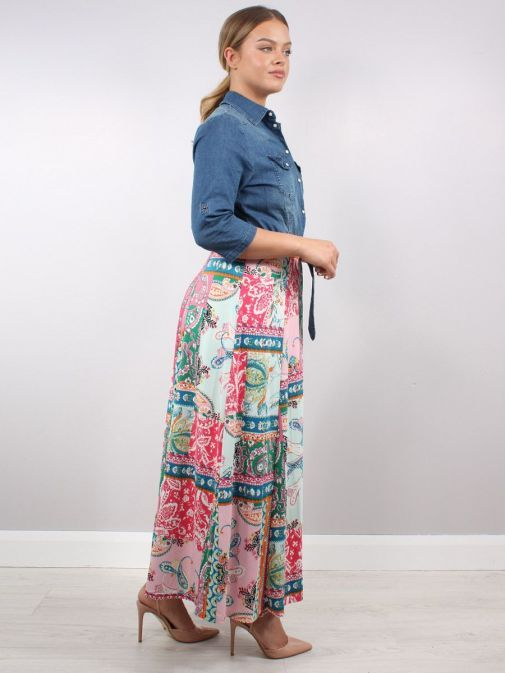 Side shot of Model wearing K Design Denim Flower Print Maxi Dress in multi-color