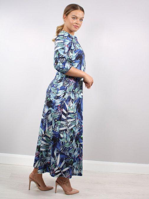 Side shot of Model wearing K Design Midnight Forest Print Maxi Dress in Blue