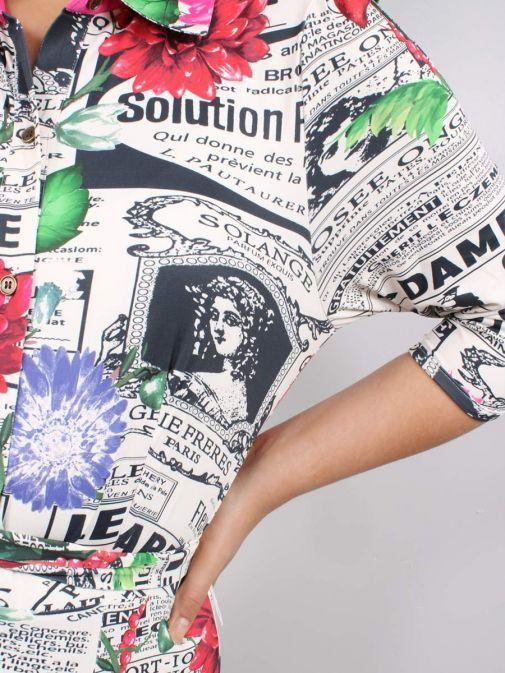 Close up of Model wearing K Design Newspaper Print Maxi Dress in Multi-Colour