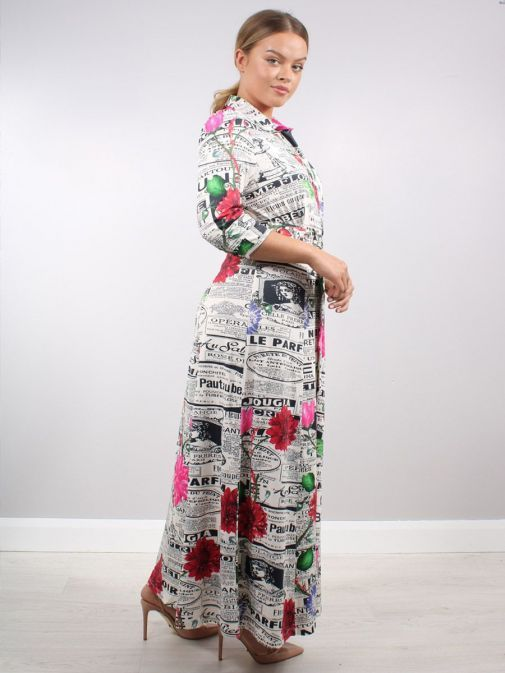 Side shot of Model wearing K Design Newspaper Print Maxi Dress in Multi-Colour