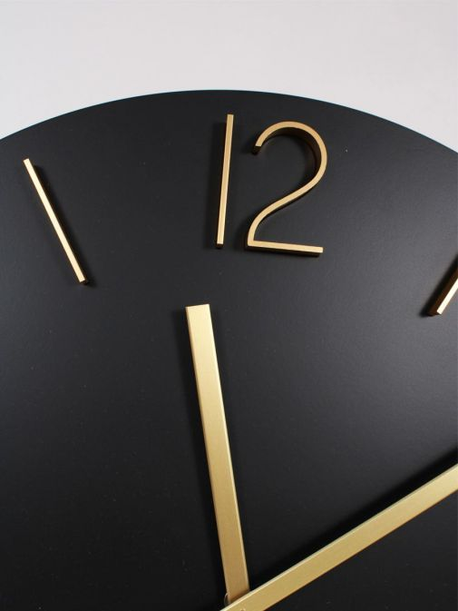 Close up of Large Round Wall Clock in Black and Gold