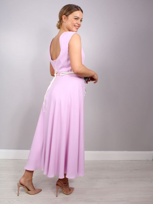 Back shot of model wearing Laura Bernal Sleeveless Midi Dress in Lilac, Style 91020400
