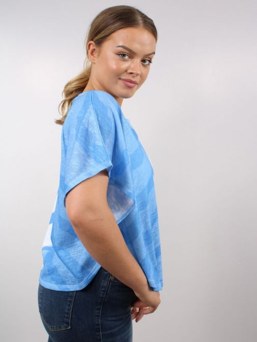 Side shot of Model wearing Marble Spray Print Top with Vest in Blue