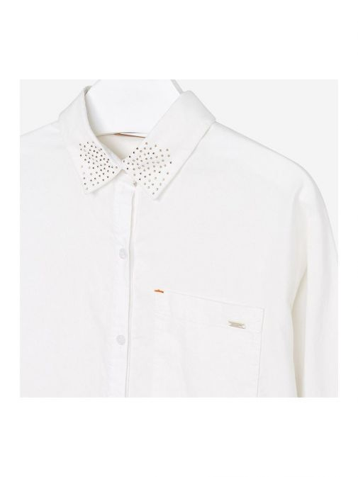 closeup of the Mayoral Shirt in the Cream colour featuring buttons, gold detailing on the collar and pocket on the chest