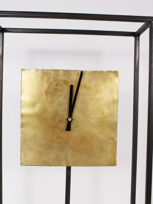 Close up of Black Frame Gold Square Clock