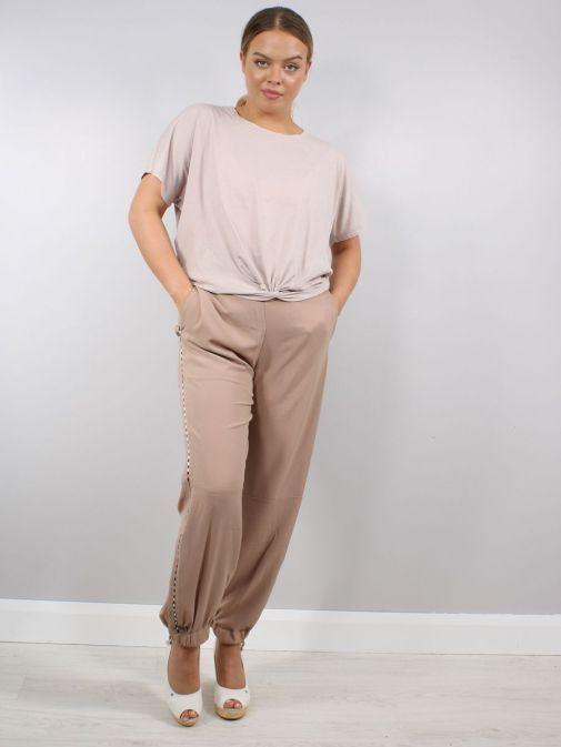 Full shot of Model wearing Religion Outlook Trousers in Beige
