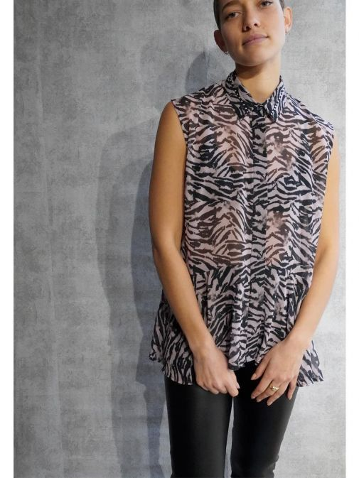 Front shot of the Religion Channel Shirt  in the Pink colour featuring shirt collar, animal print, button-through placket and has a high low peplum hem