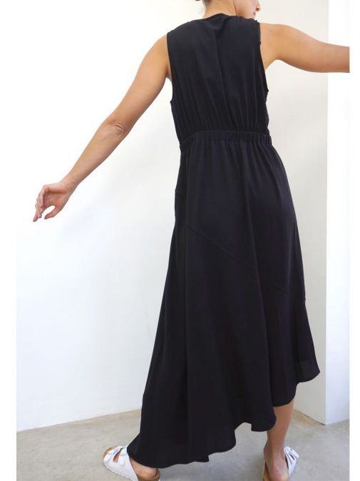 back shot of the Religion Division Dress in the Black Colour featuring an a-symmetric hem and elasticated waist