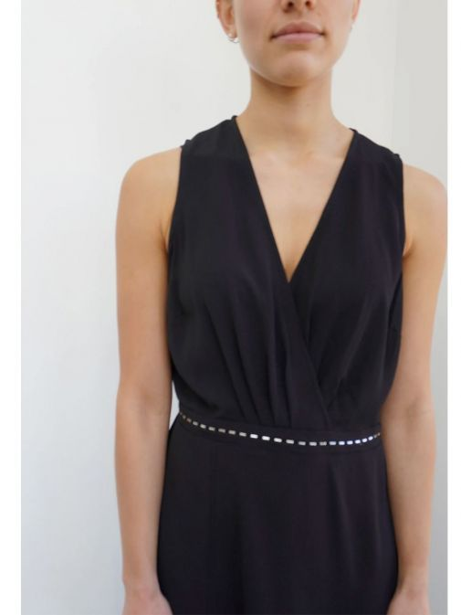 closeup shot of the Religion Division Dress in the Black Colour featuring a v-neckline, a-symmetric hem and stud detailing
