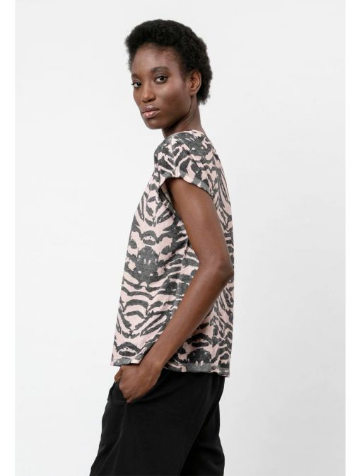 side shot of the Religion Freedom Top in the Pink colour featuring animal print, round neckline and short sleeves