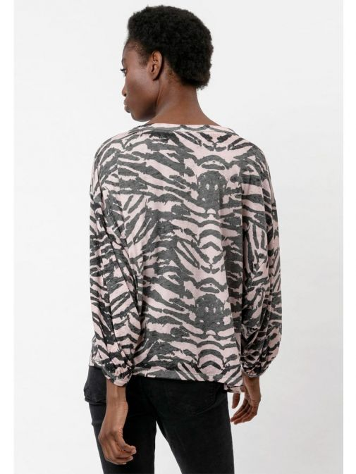 back shot of the Religion Manifest Top Washed in the Black colour featuring a wide round neckline, long batwing sleeves and animal print