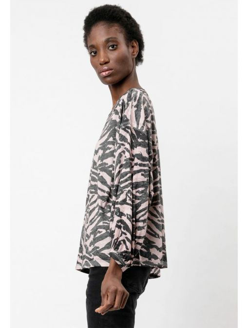side shot of the Religion Manifest Top Washed in the Black colour featuring a wide round neckline, long batwing sleeves and animal print