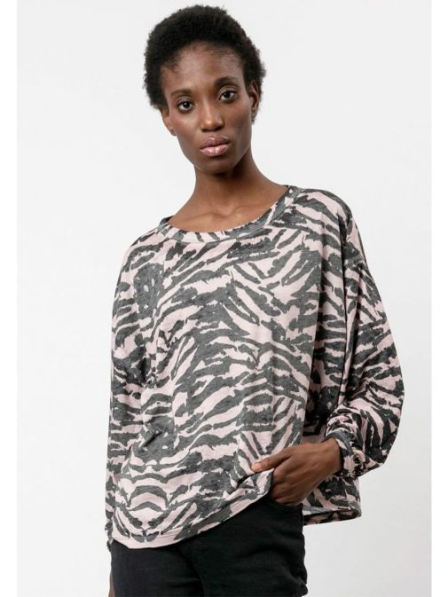 front shot of the Religion Manifest Top Washed in the Black colour featuring a wide round neckline, long batwing sleeves and animal print
