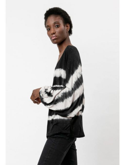 side shot of the Religion Manifest Top Washed in the Black colour featuring a wide round neckline, long batwing sleeves and a tie-dye print