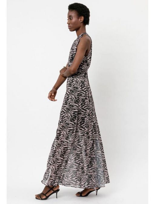 side shot of the Religion Noir Maxi Dress in the Pink colour featuring  animal print, halterneck, fitted waist and flared skirt with high slits