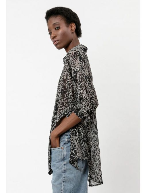 side shot of the Religion Storm Shirt in the Black colour featuring animal print, classic shirt collar, button-through placket, long sleeves and button detailing